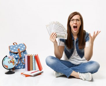 Young angry woman student screaming spreading hands holding bundle lots of dollars, cash money sit near globe backpack, books isolated on white background. Education in high school university college